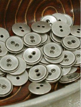 Botón metal